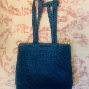 Cute big blue weaved purse.